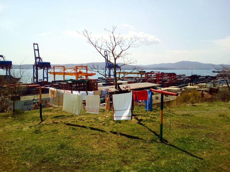 Life of my city Day Outdoors Sky Water Sea Sea Port Port Trade Port Tree Loundry Clothes Hanging Clothes Drying Multi Colored Hanging Grass Spring City City Life No People