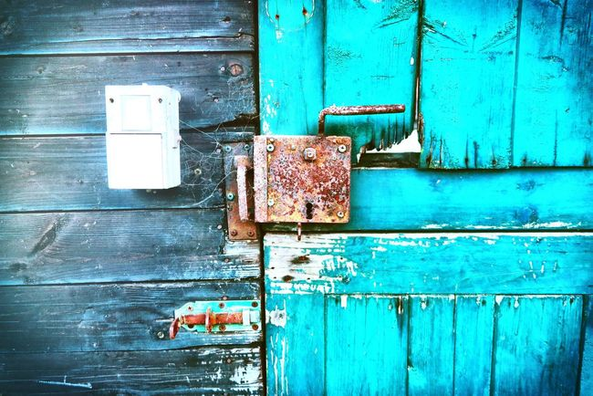 Door Wood Old Buildings Old-fashioned Old House Rusty Door Lock Colourful Electricity  Showcase: January On My Way In My Garden EyeEm Gallery No People Broken Up Close Street Photography Pastel Power Here Belongs To Me