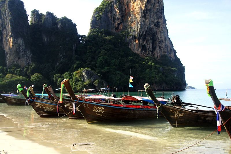 Thailand Longtailboat Railey Beach Krabi Thailand Beach Water Tree Nautical Vessel Nature Sky Plant Beach Transportation Mode Of Transportation Beauty In Nature Real People Sea Incidental People Mountain Outdoors