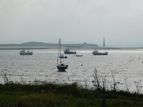 The beautiful magical and mystical island of Lindisfarne (The Holy Island) of the coast of Northumberland, England. Harbour Beach Beauty In Nature Boats Day Holy Horizon Over Water Island Lindisfarne Mode Of Transport Moored Nautical Vessel No People Northumberland Outdoors Scenics Sea Shoreline Sky Tidal Tranquil Scene Tranquility Travel Destinations Water