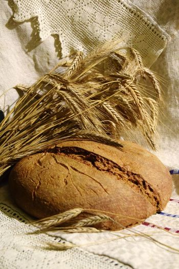 Close-up of bread in basket on bed