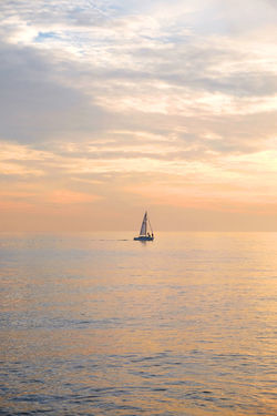 Brighton Brighton Beach Water Cloud - Sky Sea Sky Sunset Scenics - Nature Beauty In Nature Waterfront Transportation Horizon Over Water Nautical Vessel Tranquility Horizon Tranquil Scene Mode Of Transportation Orange Color Nature Sailboat No People Outdoors