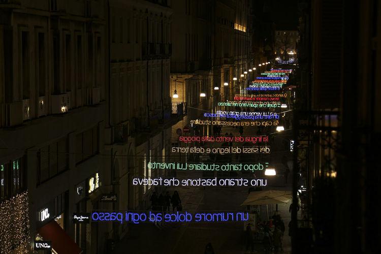 Illuminated text on building at night