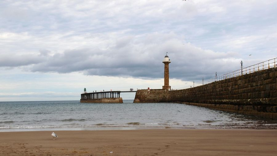 Sea Sky Beach Water Pier Whitby Pier Stone Wall Wooden Structure Sky And Clouds Lighthouse Sea And Sky Whitby Seascape Coast Scenics Outdoors Built Structure Architecture Harbour Shore Yorkshire Coast Horizon Over Water