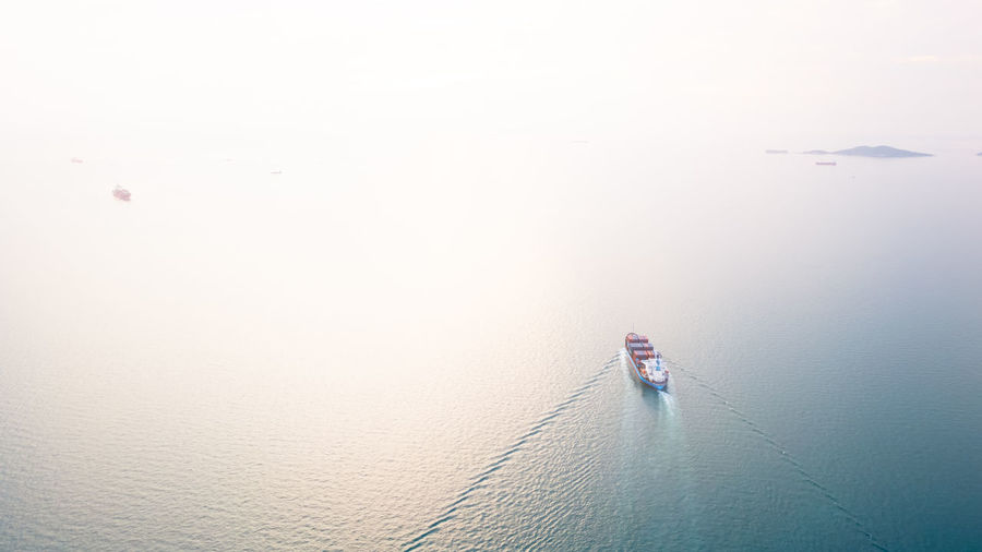 Aerial top view container cargo ship in import export business services commercial trade logistic