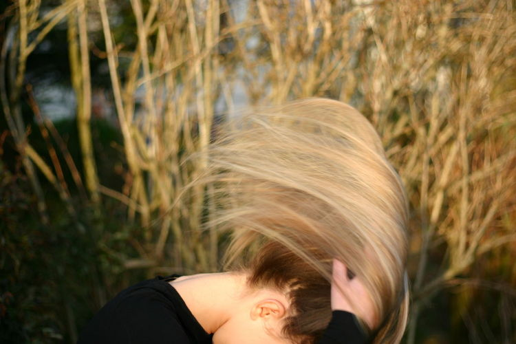Woman Tossing Hair Outdoors