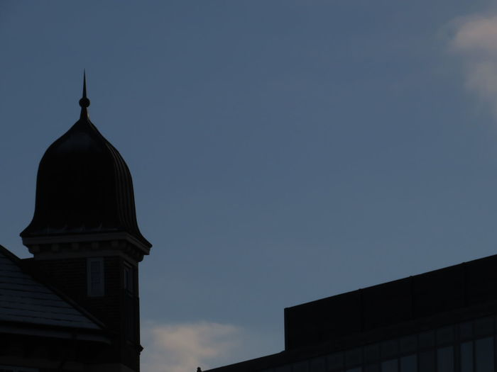 Low angle view of silhouette building against sky at dusk