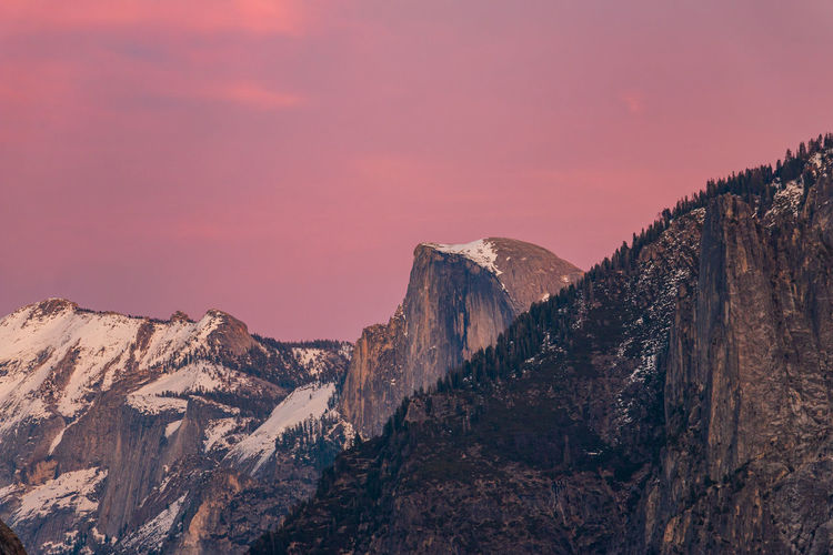 Panoramic view of half dome against sky during sunset.yosemite valley.
