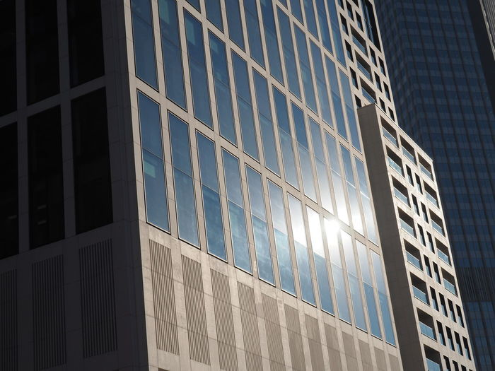 Architecture Building Exterior Built Structure Corporate Business Day Low Angle View Modern No People Outdoors Reflection Skyscraper Sunlight Window Windows