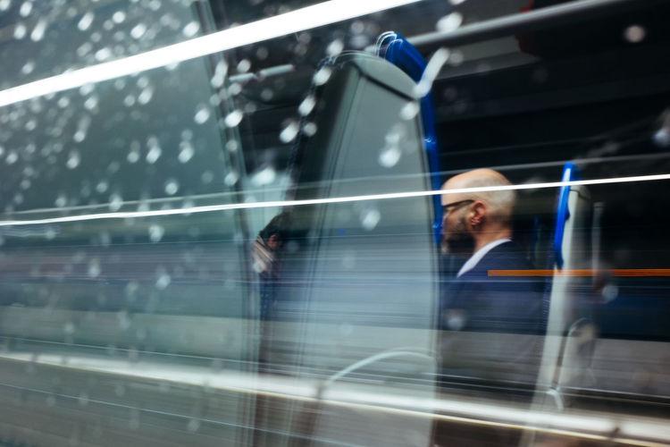Blurred motion of people walking on glass window