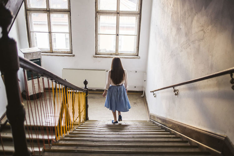 Woman walking down stairs Old House Old Buildings Day One Person Lifestyles Casual Clothing Walking Steps And Staircases Indoors  Women Window Staircase Real People EyeEmNewHere