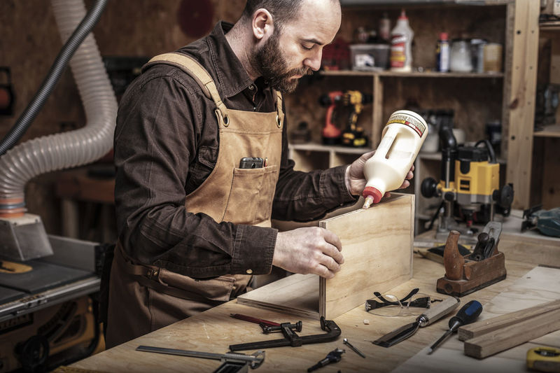 Man working at table in workshop
