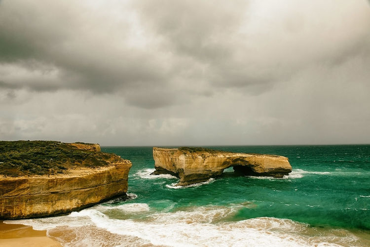 the twelve apostles-landscape , australia Nature Land Rock Formation Outdoors Tranquil Scene No People Rock - Object Rock Horizon Over Water Scenics - Nature Cloud - Sky Water Sea Sky Beauty In Nature Horizon Solid Day Beach Overcast Power In Nature Stack Rock