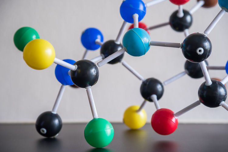 Close-up of colorful molecule models on table