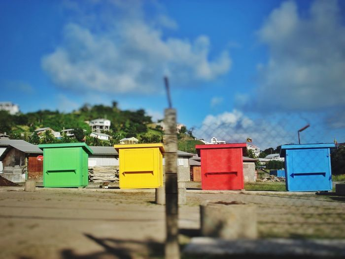 Shack Blue Red Green Yellow Marketplace Market Colors Caribbean Stalls Sky No People Outdoors Selective Focus In A Row