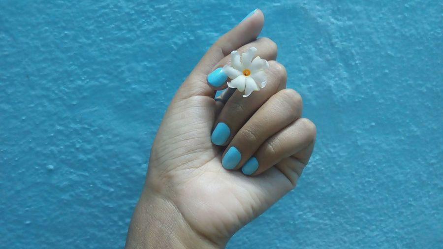 Human Body Part Human Hand Blue Close-up One Person Adults Only Outdoors Adult People Day Wall Flower Parijat Nail Polish Coral Jasmine Jasmine Collection Night Flowering Jasmine Night Queen Nature Fingernail Jasmine