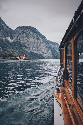 Boat on river against sky