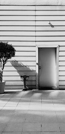 Morning Sun Closedoor Door Sun Shade Shadow Streetphotography Blackandwhite EyeEm Selects EyeEm Best Shots EyeEmNewHere EyeEm Nature Lover EyeEm Gallery EyeEmBestPics EyeEm Corrugated Iron Factory Shutter Architecture Building Exterior Built Structure Latch Door Entryway