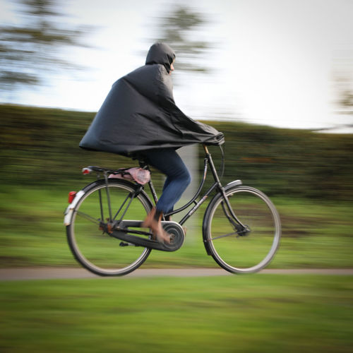 Man riding bicycle on grass