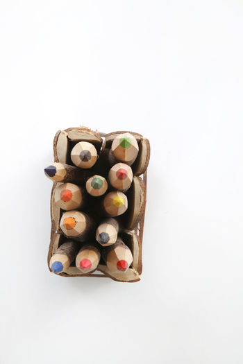 Close-up of candies against white background