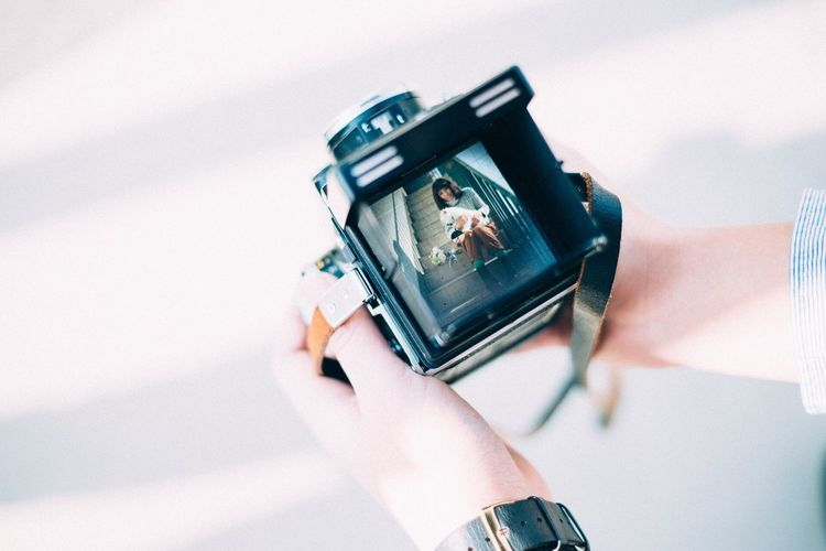 Close-up of woman hand holding camera