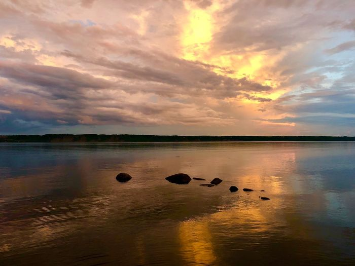 Water Sky Sunset Cloud - Sky Beauty In Nature Scenics - Nature Tranquility Tranquil Scene Reflection Nature Land Sea Orange Color No People Beach Idyllic Non-urban Scene Outdoors
