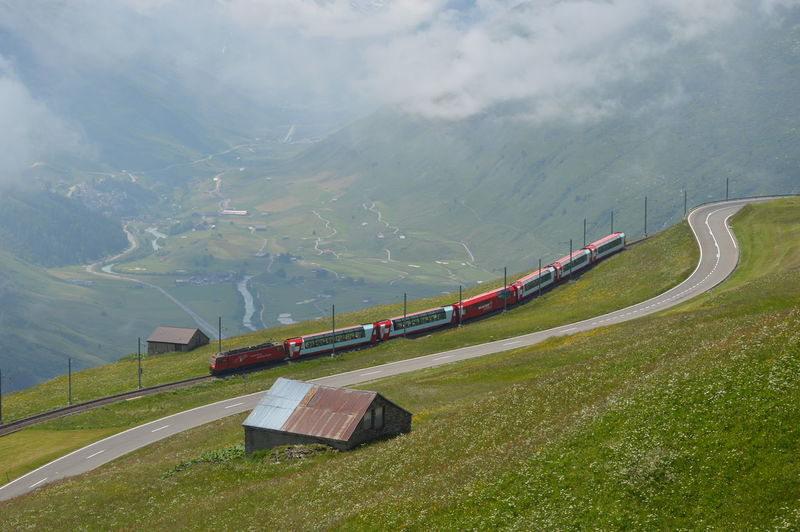 Distant view of train with mountain range in background