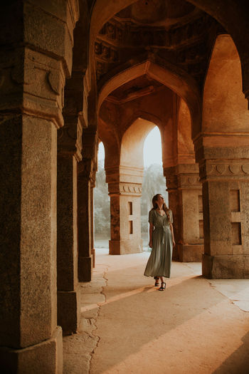 Full length of woman in historical building