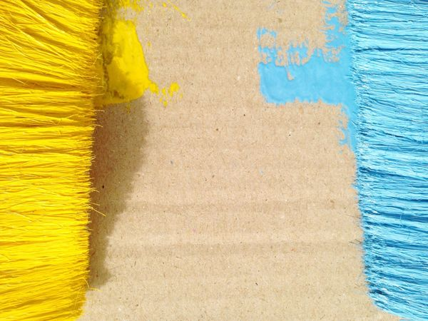 Yellow brush and blue brush use for painting background Wallpaper Floor Backdrop Colorful Wood - Material Building Exterior Outdoors Paint Architecture Day No People Pattern Close-up Built Structure Textured  Wall - Building Feature Full Frame Yellow Blue Backgrounds Weathered Vegetable Table Indoors Outdoors View