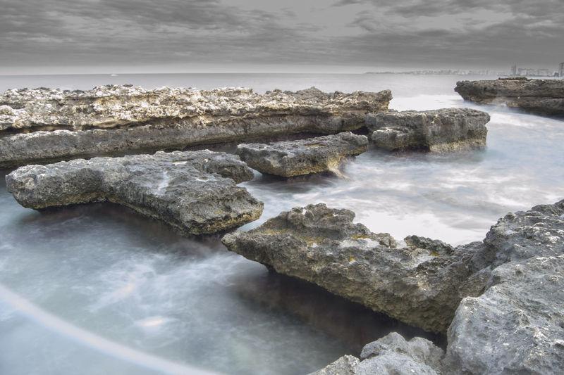 Water Landscape Scenics Sea Beauty In Nature Horizon Over Water Outdoors Beach El Campello Los Baños De La Reina Rock Formation Rocks And Water Rocks In Water Rocks And Sea Historycal Place Roman Ruins