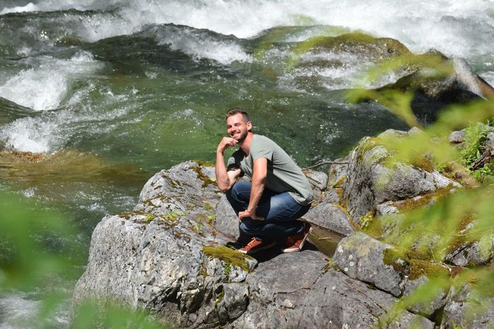 Sitting at the river posing! River Posing Sunny Summer Smile Washington State Leavenworth Rock - Object One Man Only Nature Adventure Outdoors