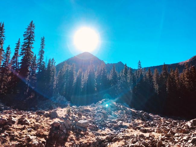 Sun peck Lens Flare Sunlight Mountain Sunbeam Nature Beauty In Nature Tranquility