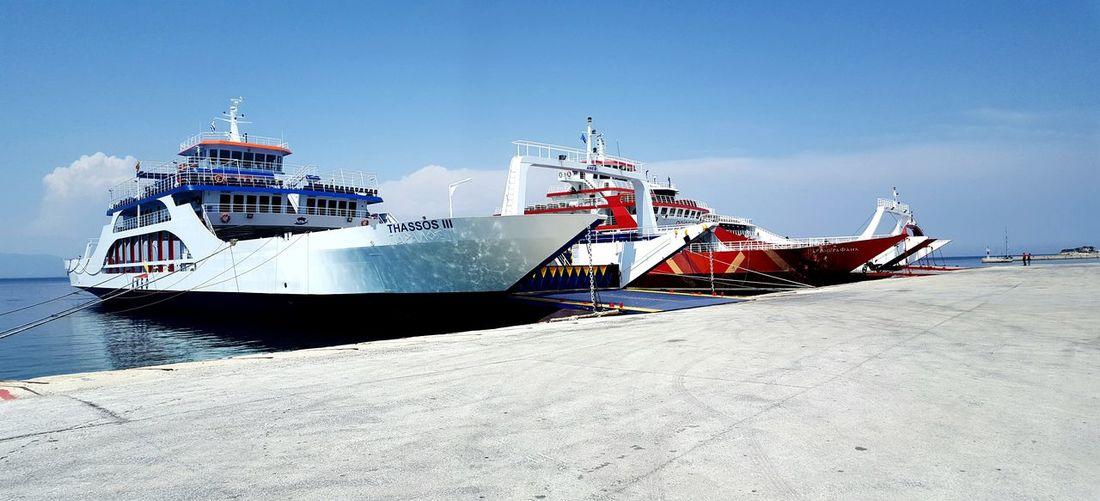 Ship moored on sea against sky