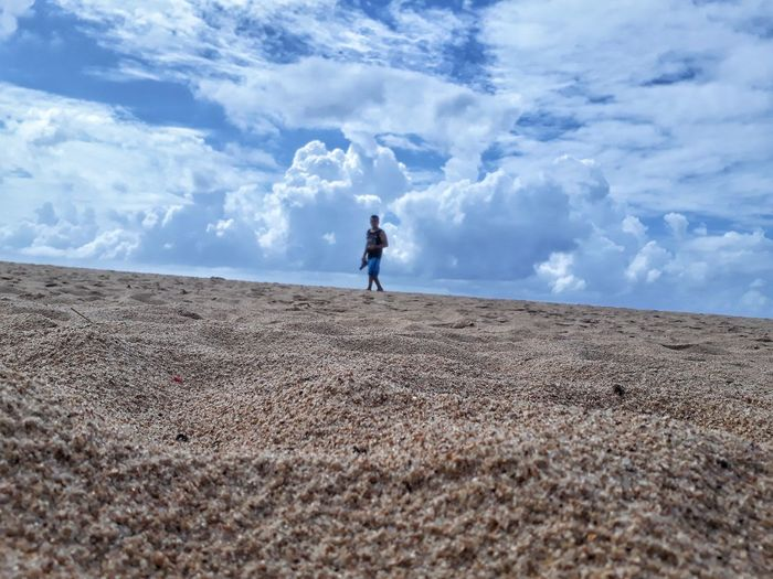 Beach Praia Cloud - Sky Desert Sky Sand Outdoors Sand Dune Day Beauty In Nature Nature One Person Full Length Child People Children Only Arid Climate Landscape One Boy Only Adult