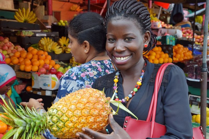 Pineapple Young Women Portrait Smiling Women Fruit Looking At Camera Happiness Business Cheerful Headshot Market Vendor Flower Market Street Market For Sale Adventures In The City