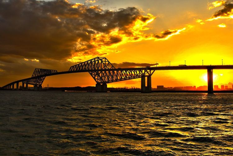 Harbor Sunset Built Structure Architecture Water Waterfront Orange Color Connection Scenics Idyllic Cloud - Sky Beauty In Nature Bridge - Man Made Structure Dramatic Sky Pier River Sky Rippled Tranquil Scene Tranquility Nature