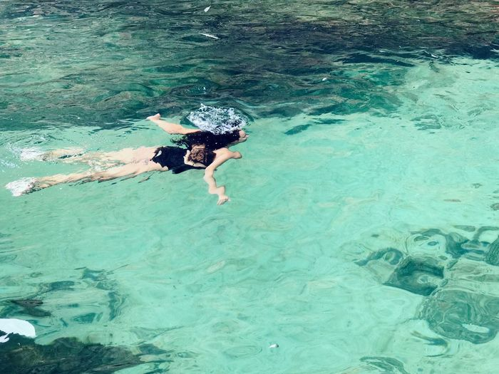 High angle view of woman swimming