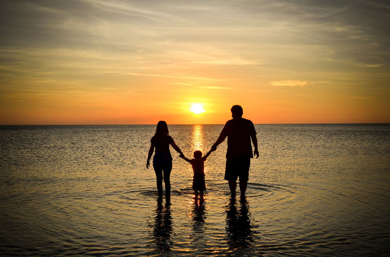 Family sihlleoutte on the beach during sunset Sunset Sea Two People Beach Horizon Over Water Silhouette People Family Men Outdoors Togetherness Scenics Occupation Golf Club Adult Only Men Teamwork Adults Only Golfer