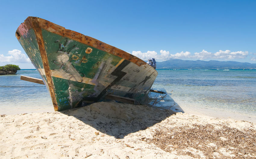Wreck on white tropical beach - Le Gosier island - Guadeloupe Caribbean sea Antilles Atlantic Beach Boat Caribbean Caribbean Sea Gosier Guadalupe Guadeloupe Island Le Gosier Nature Nautical Vessel Ocean Sand Scenics Sea Shipwreck Shipwreck Beach Sky Tropic Tropical Water White Wreck
