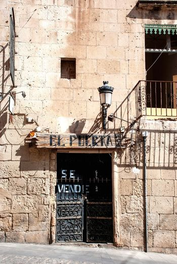 For sale Shabby House Building Ruined For Sale Spanish SPAIN Alicante Architecture Building Exterior Built Structure Building Day No People Sunlight Wall - Building Feature Entrance Outdoors Door Closed Wall City Window
