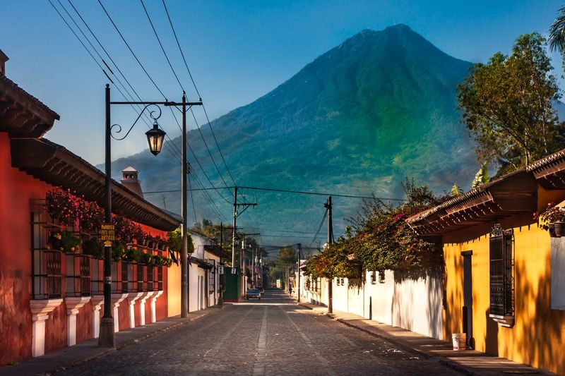 Antigua Mountain Architecture Sky Built Structure Building Exterior The Way Forward Nature Electricity  Tree Lighting Equipment Plant Street Building Direction No People Cable Diminishing Perspective Decoration Road City