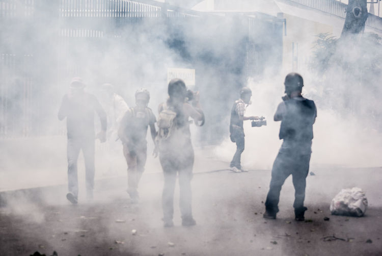 Protestors Standing In Smoke