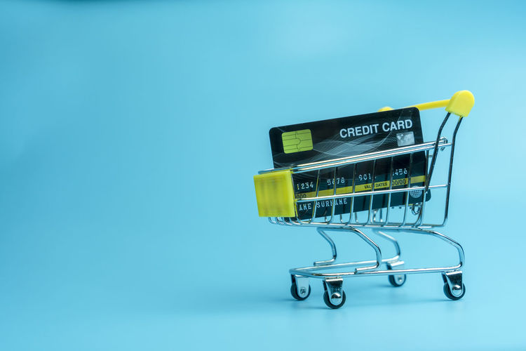 cart sale online shopping by credit card on empty blue space background Communication Blue Background Close-up Shopping Metal Retail  Indoors  Shopping Cart No People Copy Space Colored Background Still Life Western Script Online Marketing Online Shopping  Online Purchase Credit Card Copy Space