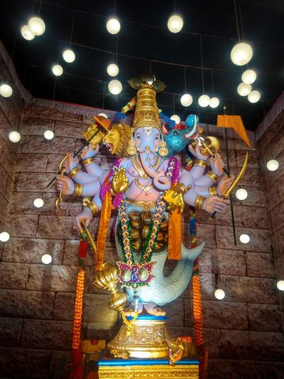 MY CLICK📷 🙏LORD GANESHA 🙏 Myclick💚 IndianFestivals GanpatiBappaMorya #LordGanesha Illuminated Statue Hanging Spirituality Tradition Religion Multi Colored Cultures Close-up