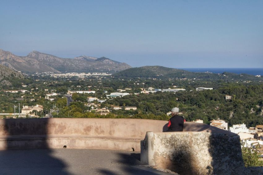 Bench Holiday Mallorca Panorama SPAIN Architecture Building Exterior Built Structure Clear Sky Day Leisure Activity Lifestyles Mountain Nature One Person Outdoors People Real People Retaining Wall Scenics Sitting Sky Sunlight Young Adult Young Women Lost In The Landscape