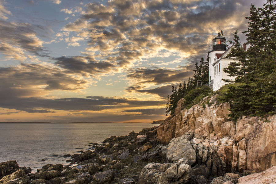 Sunset behind Bass Harbor Head Lighthouse, Maine, United States Bass Harbor Lighthouse Bass Harbor Cliff Cloud - Sky Lighthouse Nature Ocean Sea Sky Sunset Water