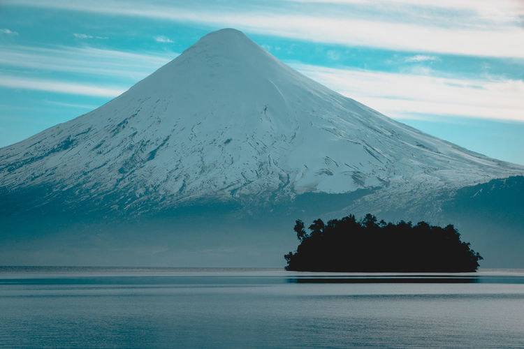 Osorno volcano... Beauty In Nature Cloud - Sky Cold Temperature Idyllic Land Mountain Mountain Peak Nature No People Non-urban Scene Outdoors Scenics Scenics - Nature Sea Sky Snow Snowcapped Mountain Tourism Tranquil Scene Tranquility Travel Destinations Water Waterfront Winter