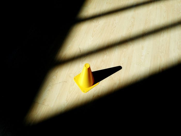yellow Shadow Indoors  Close-up Day Indoor Lighting Sunlight Sport Indoors  Room Yellow Cone Colors Clear Sky Bright Triangle