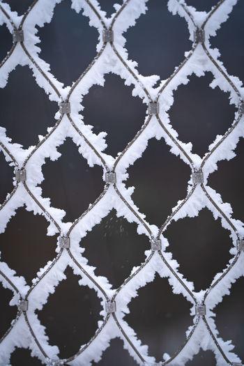 Full frame shot of chainlink fence during winter