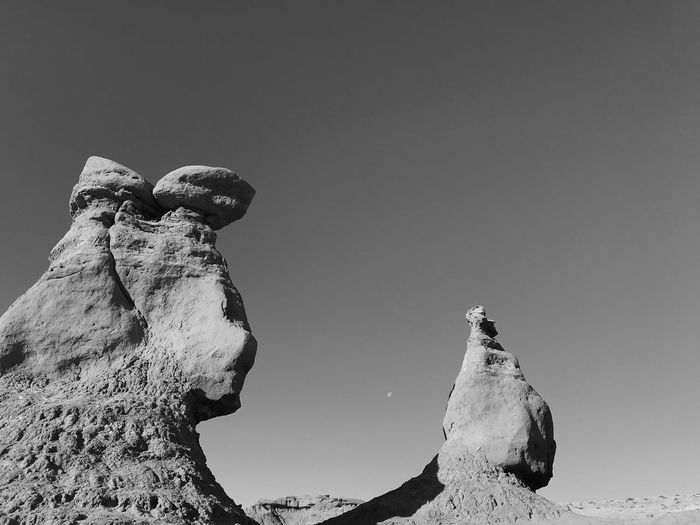 Black and white view of tall rock formations in Goblin Valley State Park Goblin Valley State Park, Utah Rounded Stones Stone Formation Black And White EyeEm Selects Sky Low Angle View Clear Sky Nature No People Copy Space Outdoors Day Tranquility Travel Beauty In Nature Travel Destinations